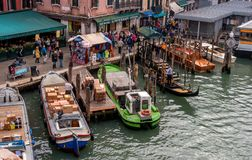 Venice, Italy - October 13, 2017: pier on the Grand Canal. On the first plan, unloading of cargo boats. On the Royalty Free Stock Photos