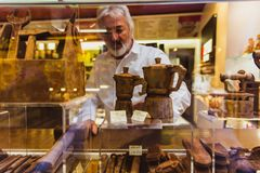 VENICE, ITALY - OCTOBER 27, 2016: shop window with handmade chocolate products in Venice, Italy stock image