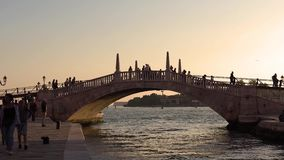 VENICE, ITALY - OCTOBER, 2017: Tourists walking the streets of Venice. Evening in Venice. Tourists walking along the stock footage