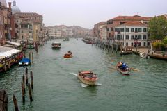 Venice, Italy - October 13, 2017: view of the Grand Canal. Boats, boats and river trams are sailing along the canal. The Stock Photos