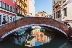 VENICE, ITALY - OKTOBER 27, 2016: colorful corners with old classic buildings, small bridge and little water canal in Venice, royalty free stock photography