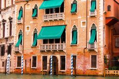Venice, Italy. Old, architecture, city, house, brick, red, over hang, tunnel, hallway, stone, gondola, Gondoliere,boat, ancient, wall, street lights,shutters Royalty Free Stock Images