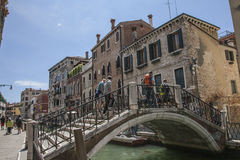 Venice, Italy - old buildings by a canal/a bridge. This image is showing one of the canals in Venice, Italy. It was taken in June 2017 on a sunny day. You can royalty free stock photography