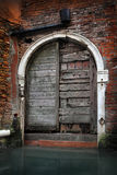 Venice, Italy, Old Door By Canal Royalty Free Stock Images