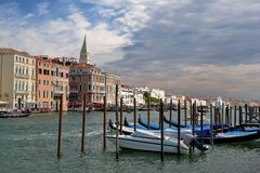 Venice, Italy. Parked motor boat and gondolas in a row Royalty Free Stock Photo
