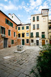 Venice, Italy Plaza. A private plaza in Venice with blue sky and well royalty free stock photo