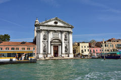 Venice. ITALY - SEPT 24, 2014: View on the  seafront and Gesuati church facade. Tourists from all the world enjoy the historical city of Venezia in Italy Stock Images