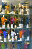 VENICE, ITALY - SEPTEMBER 24,  2010: bright gloves on a window of shop Stock Photo