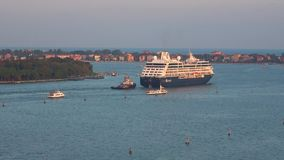 Cruise ship `Azamara Quest` comes from the Venetian lagoon. Venice, Italy. VENICE, ITALY - SEPTEMBER 26, 2017: Cruise ship `Azamara Quest` comes from the stock video