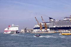 VENICE, ITALY - SEPTEMBER 24, 2010: Cruise ships brought tourists.  royalty free stock image