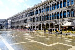 VENICE, ITALY - SEPTEMBER 12, 2017 - Giant puddle on the St. Mark square after the flood. Piazza San Marco. Flood in Venice. VENICE, ITALY - SEPTEMBER 12, 2017 royalty free stock image