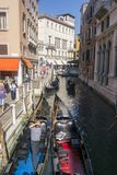 Venice, Italy - SEPTEMBER 8, 2016. Gondoliers rolled tourists in. A narrow channel Stock Images