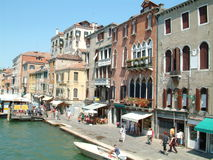 Venice, Italy - September 5, 2016: Mooring pile, boat and buildings at Canal in Venice, Italy. Stock Photography