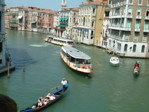 Venice, Italy - September 5, 2016: Mooring pile, boat and buildings at Canal in Venice, Italy. Royalty Free Stock Photos
