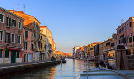Venice, Italy - September 2, 2016. Morning in Venice reflected in canal waters. Venice, Italy, reflected, canal, waters, cute Stock Images
