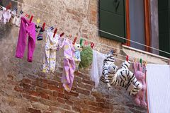 Typical view of the streets of Venice; washed children clothes drying on Royalty Free Stock Photos
