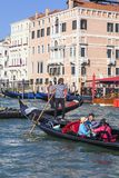 Venetian gondoliers in gondolas with tourists on Grand Canal, Venice, Italy. VENICE, ITALY-SEPTEMBER 21, 2017: Venetian gondoliers in gondolas with tourists on Stock Photo
