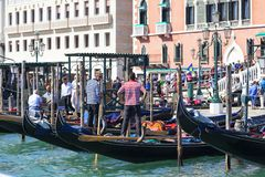 Venetian gondoliers at the marina of the gondolas, Grand Canal.Venice, Italy Stock Photography