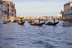 Venice gondoliers on gondolas with tourists on the Grand Canal ,Venice, Italy. VENICE, ITALY-SEPTEMBER 20, 2017: Venice gondoliers on gondolas with tourists on Stock Photos