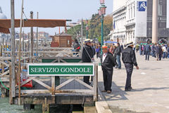 Venice, Italy. Servizio gondole. The gondola is a traditional, flat-bottomed Venetian rowing boat, well suited to the conditions of the Venetian lagoon. The Stock Images