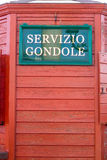 Venice Italy sign advertising Servicio Gondole (Gondola Service) with red wood background. Venice Italy sign advertising (Gondola Service) with red wood royalty free stock image
