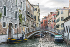 Venice in Italy. Small canal with motorboats watertaxi and bridce  in Venice , Italy , Europe Royalty Free Stock Images
