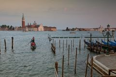 Venice in Italy / Sunset view of the river canal and traditional venetian architecture Royalty Free Stock Photography