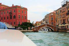 Venice, Italy. Tourist, tourism, old, architecture, city, house, brick, window, water, plants, apartment, bridge, boat, people, red, brick Royalty Free Stock Photos