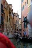 Venice, Italy. Tourist, tourism, old, architecture, city, house, brick, window, water, plants, shutters, tunnel, apartment Stock Photos