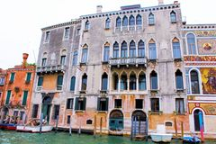Venice, Italy. Tourist, tourism, old, architecture, city, house, brick, window, water, plants, shutters, tunnel, apartment Royalty Free Stock Photos
