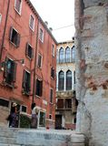 Venice, Italy. Tourist, tourism, old, architecture, city, house, window, brick, theater, window, women, wood Royalty Free Stock Photo