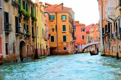 Venice, Italy. Tourist, tourism, old, architecture, city, house, window, brick, theater, window, women, wood, gondola, gondolier, oar, canal, water, plants Stock Photo