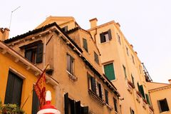 Venice, Italy. Tourist, tourism, old, architecture, city, house, window, water, plants, brick, trees, yellow, green, dome, stairs,street lights Royalty Free Stock Photo
