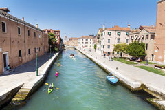 Venice, Italy - tourists with colorful canoes Stock Images