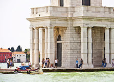 Venice, Italy - Tourists relax against the pillars of Punta dell Stock Image