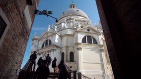 Venice Italy.Tourists visiting Santa Maria della Salute Church stock footage