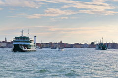 Venice, Italy. Two ferryboats and motor boats in Grand Canal Royalty Free Stock Image