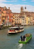 Venice, Italy: Two floating ships with people Royalty Free Stock Images