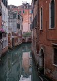 Typical canal scene in Venice with reflection in the water. Venice Italy. Typical canal scene in Venice with reflection in the water stock image