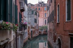 Typical canal scene in Venice with reflection in the water. Venice Italy. Typical canal scene in Venice with reflection in the water stock photos