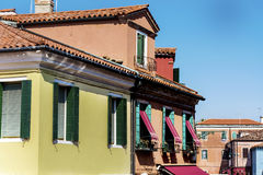 Venice ,Italy  ,typical italian building with beautiful windows. Traditional  italian building with beautiful windows ,green shutters and awnings Stock Photography