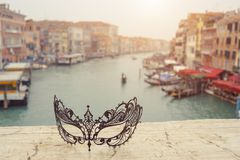 Venice, Italy .Venetian masks on bridge agaist landscape Grand Canal stock images