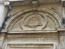 """Venice, Italy. Venice's Church of the Maddalena portal with masonic symbols over the door and Sapientia Aedificavit Sibi Domum is Latin for """"Wisdom Has Built Stock Images"""