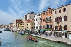 Venice, Italy. MAY 06 : Canal with crowd of tourist on May 06, 2014 in Venice. Venice is very famous tourist destination of Italy. Many tourists visiting all Royalty Free Stock Image
