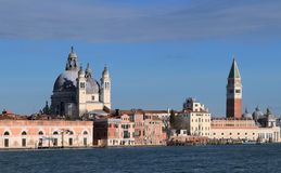 Venice, Italy. A view of the island of Dorsoduro taken from Giudecca Canal. The iconic Campanile di San Marco and the church of Santa Maria Della Salute royalty free stock images