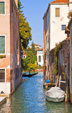 Venice, Italy - view of narrow canal with gondola Stock Photography