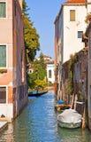 Venice, Italy - view of narrow canal with gondola Stock Photography