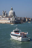 VENICE/ITALY Water taxis and buses in front Stock Images