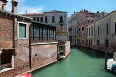 Venice - Italy. Waterway in Venice, houses,parking boats,entrances,windows, and garden door Royalty Free Stock Images