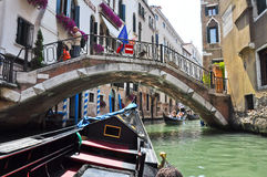 VENICE-JUNE 15: Gondola on the Venetian canal on June 15, 2012 in Venice, Italy. Stock Photography